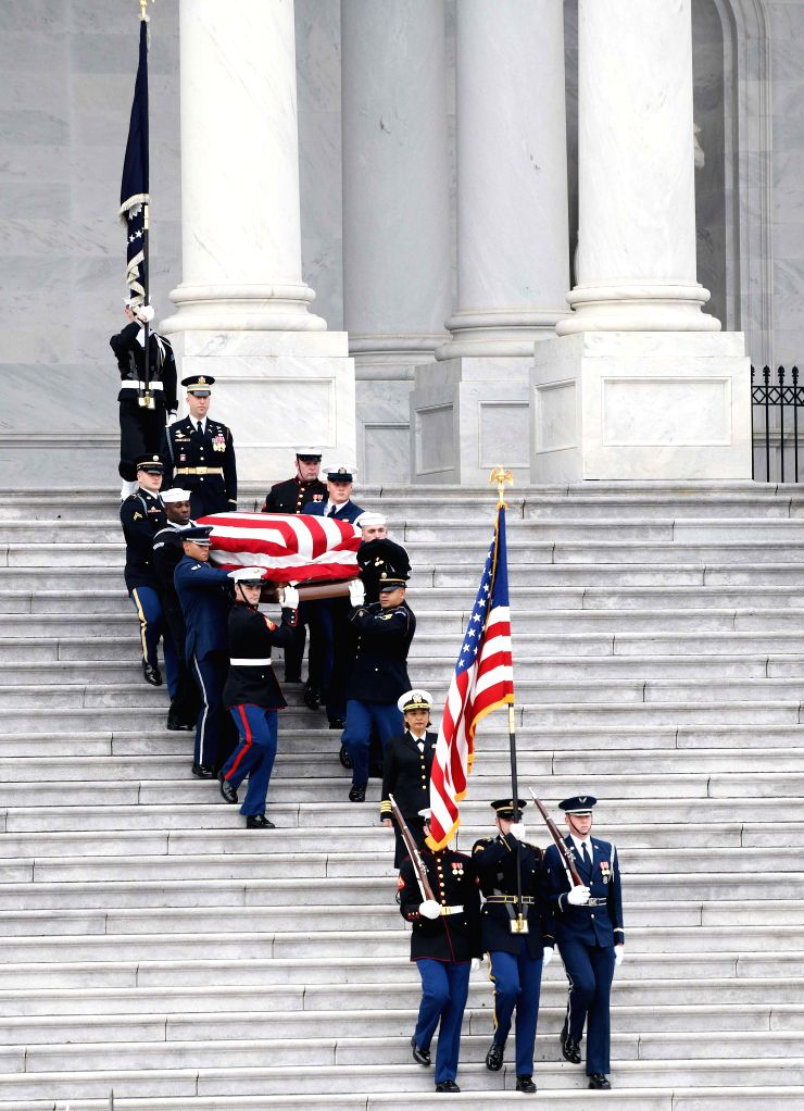 WASHINGTON, Dec. 5, 2018 - The casket of former U.S. President George H.W. Bush is carried out of the U.S. Capitol for a state funeral in Washington D.C., the United States, on Dec. 5, 2018. In ...