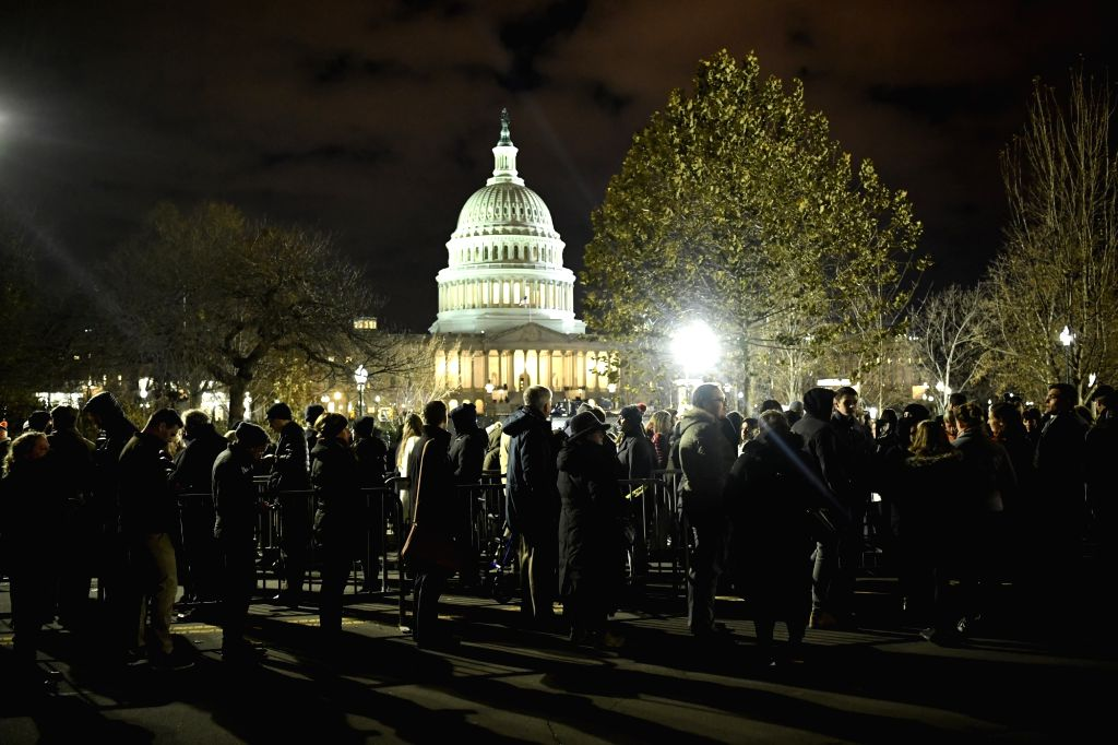 WASHINGTON, Dec. 5, 2018 - Visitors wait in line before entering the Capitol Hill to pay their respects to late former U.S. President George H.W. Bush lying in state in the U.S. Capitol Rotunda, in ...