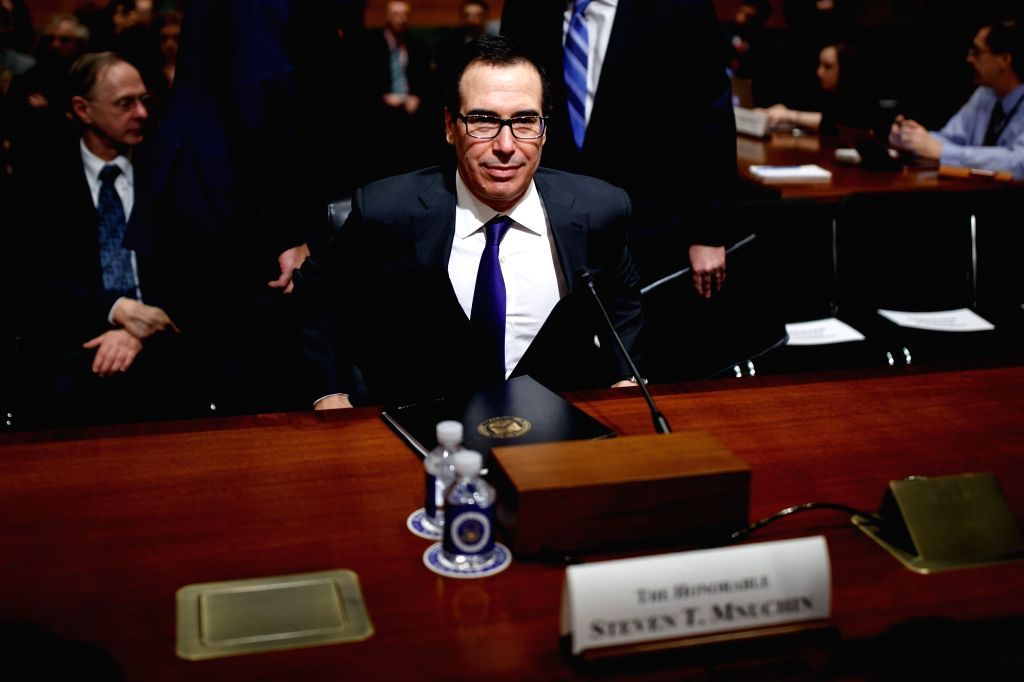 WASHINGTON, Feb. 14, 2018 - U.S. Treasury Secretary Steve Mnuchin arrives to testify before a Senate Finance Committee hearing regarding the budget for fiscal year 2019 at the Capitol in Washington ...
