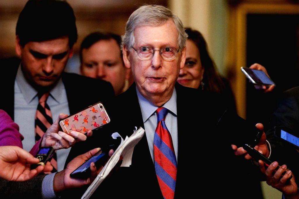 WASHINGTON, Feb. 14, 2019 - U.S. Senate Majority er Mitch McConnell (C) speaks to media in Washington D.C., the United States, on Feb. 14, 2019. U.S. President Donald Trump prepares to sign a ...
