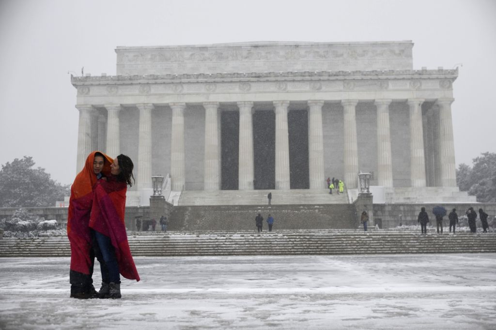 WASHINGTON, Feb. 20, 2019 - People stand in snow near the Lincoln Memorial in Washington D.C., the United States, on Feb. 20, 2019.