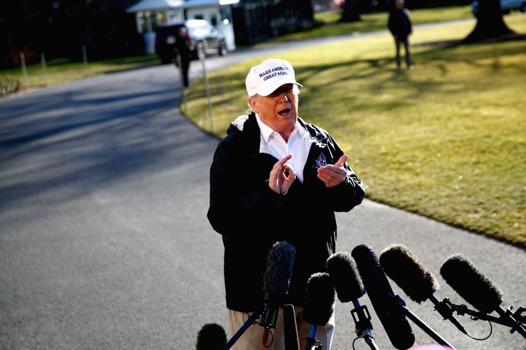 """WASHINGTON, Jan. 10, 2019 (Xinhua) -- U.S. President Donald Trump speaks to reporters before leaving the White House in Washington D.C., the United States, on Jan. 10, 2019. Donald Trump said Thursday he """"would almost say definitely"""" that he would de"""