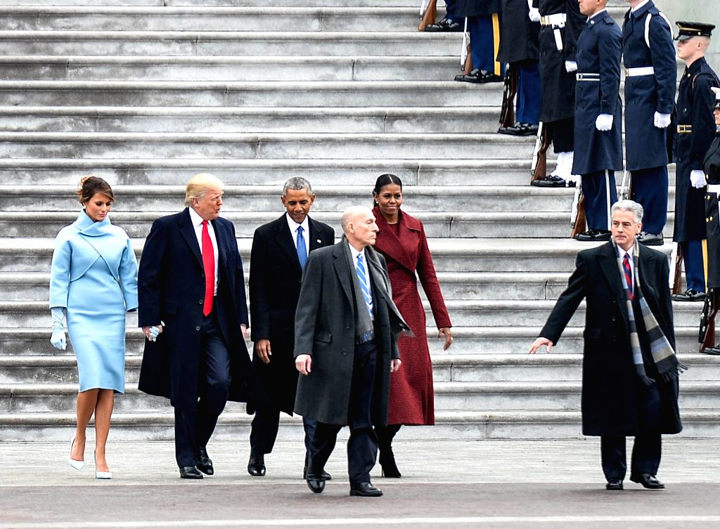 WASHINGTON, Jan. 20, 2017 - Former U.S. President Barack Obama and his wife Michelle Obama walk to the helicopter escorted by newly-inaugurated U.S. President Donald Trump and his wife Melania Trump ...