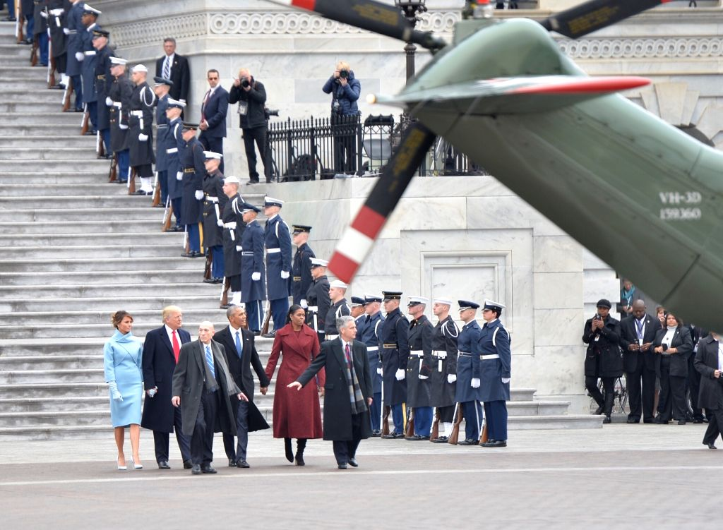 WASHINGTON, Jan. 20, 2017 - U.S. former President Barack Obama and his wife Michelle Obama walk to the helicopter escorted by newly-inaugurated U.S. President Donald Trump and his wife Melania Trump ...