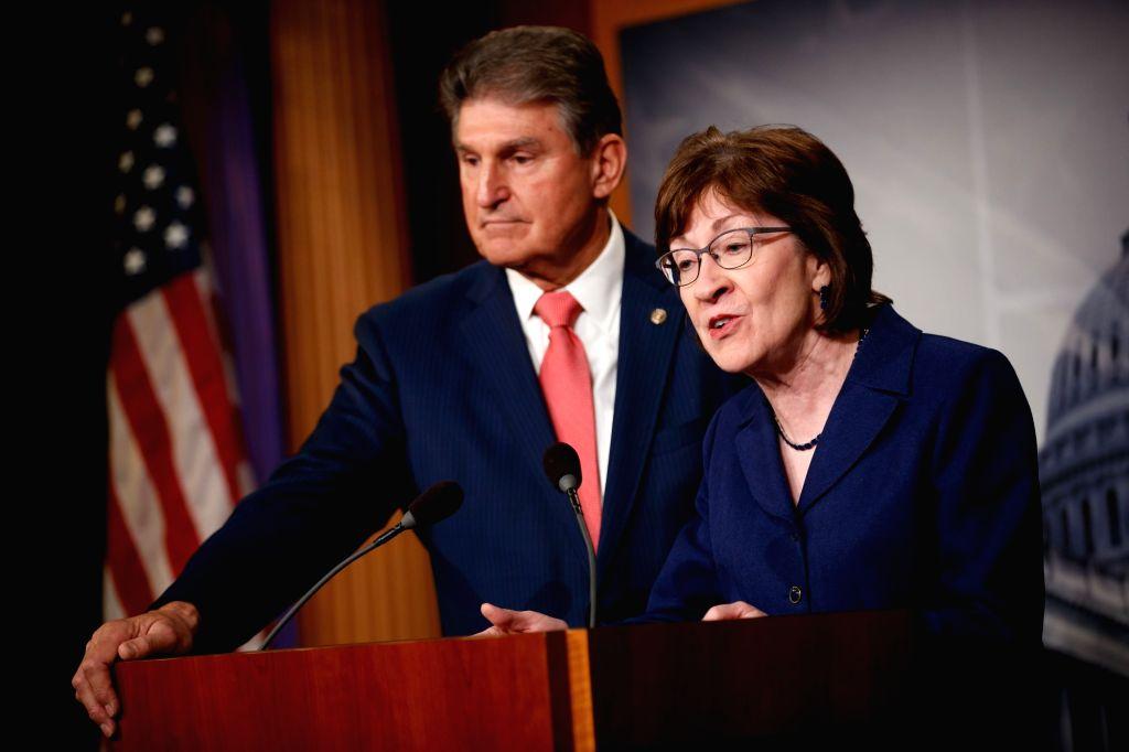 WASHINGTON, Jan. 22, 2018 - U.S Senator Susan Collins (R) and Senator Joe Manchin hold a press conference before a vote to end government shutdown on Capitol in Washington D.C., the United States, on ...