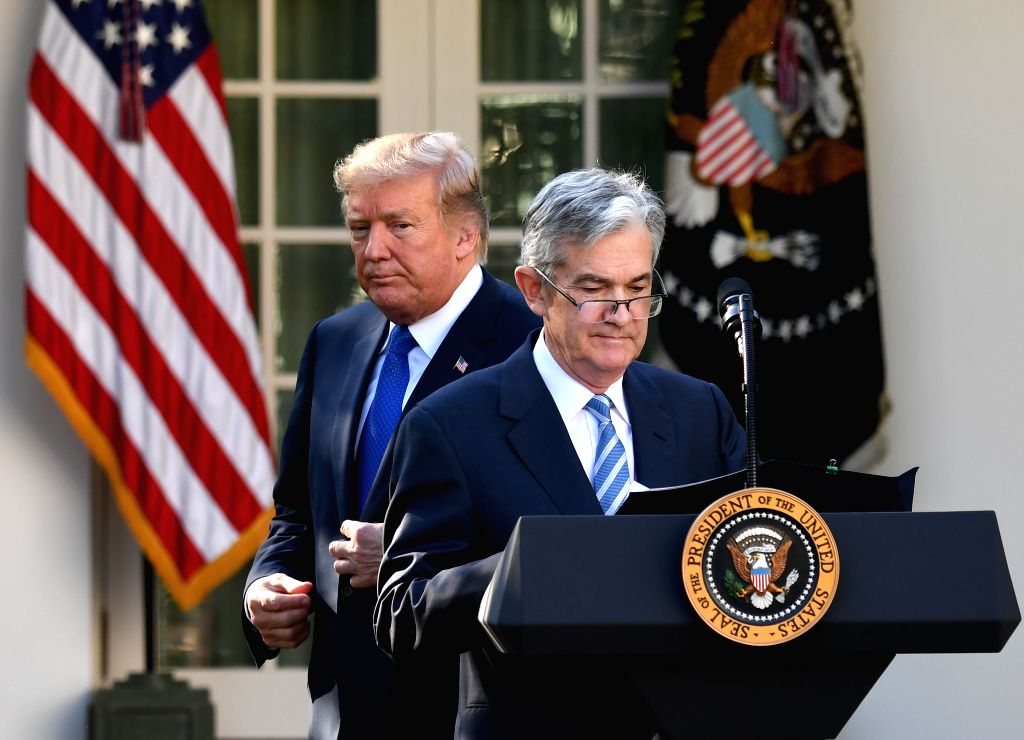 WASHINGTON, Jan. 24, 2018 - File photo taken on Nov. 2, 2017 shows U.S. President Donald Trump (L) and Federal Reserve Governor Jerome Powell at a nomination ceremony at the White House in Washington ...