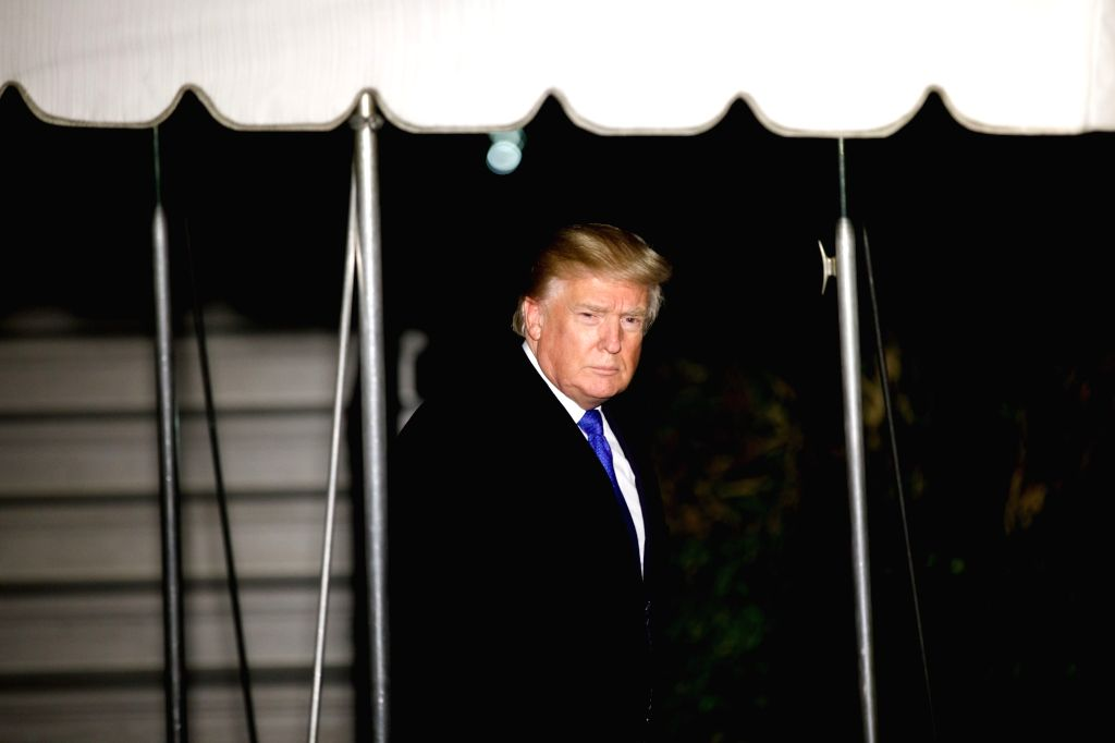 WASHINGTON, Jan. 25, 2018 (Xinhua) -- U.S. President Donald Trump leaves the White House for the World Economic Forum in Davos Switzerland, in Washington D.C., the United States, on Jan. 24, 2018. U.S. President Donald Trump spoke by phone with his T