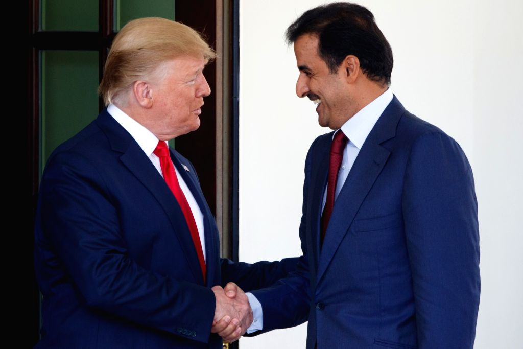 Washington, July 10, 2019 (Xinhua) -- U.S. President Donald Trump (L) welcomes Qatari Emir Sheikh Tamim Bin Hamad Al-Thani at the White House in Washington D.C., the United States, on July 9, 2019. (Xinhua/Ting Shen/IANS)