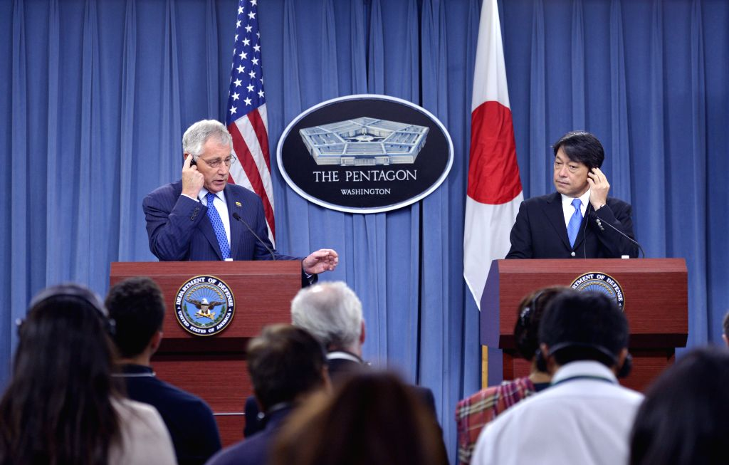 U.S. Secretary of Defense Chuck Hagel (L) and Japanese Defense Minister Itsunori Onodera attend a press briefing after their meeting at the Pentagon in ...