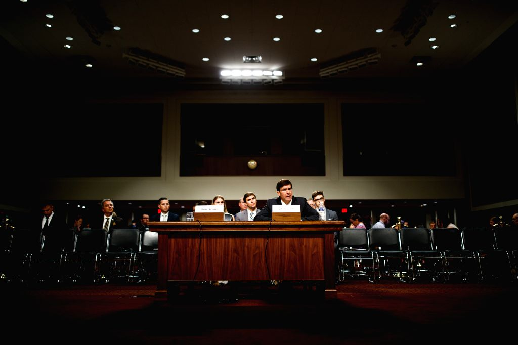 WASHINGTON, July 16, 2019 - U.S. Secretary of Defense nominee Mark Esper (front) testifies before the Senate Armed Services Committee during his confirmation hearing on Capitol Hill in Washington ...