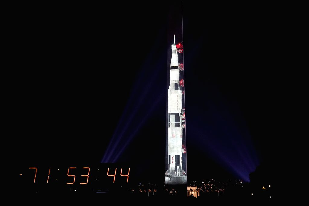 WASHINGTON , July 17, 2019 - An image of a Saturn V rocket, which was used during Apollo 11 moon landing mission, is projected on the Washington Monument in Washington D.C., the United States, July ...