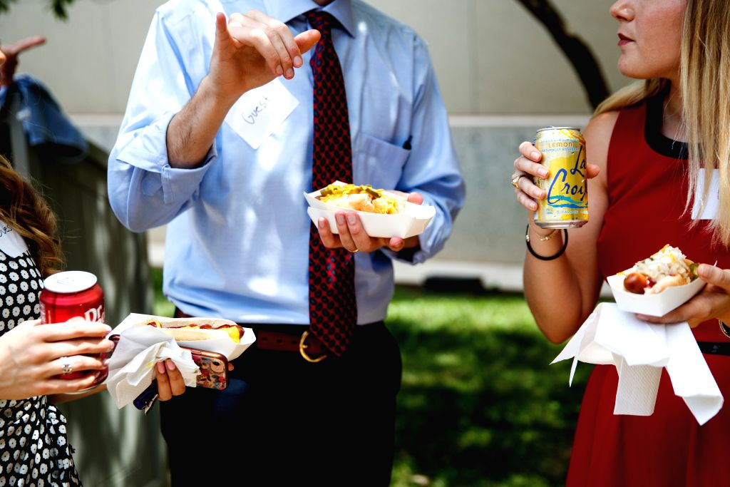 WASHINGTON, July 17, 2019 - People eat hot dogs during the annual Hot Dog Lunch event at the Rayburn House Office Building on Capitol Hill in Washington D.C., the United States, on July 17, 2019. The ...