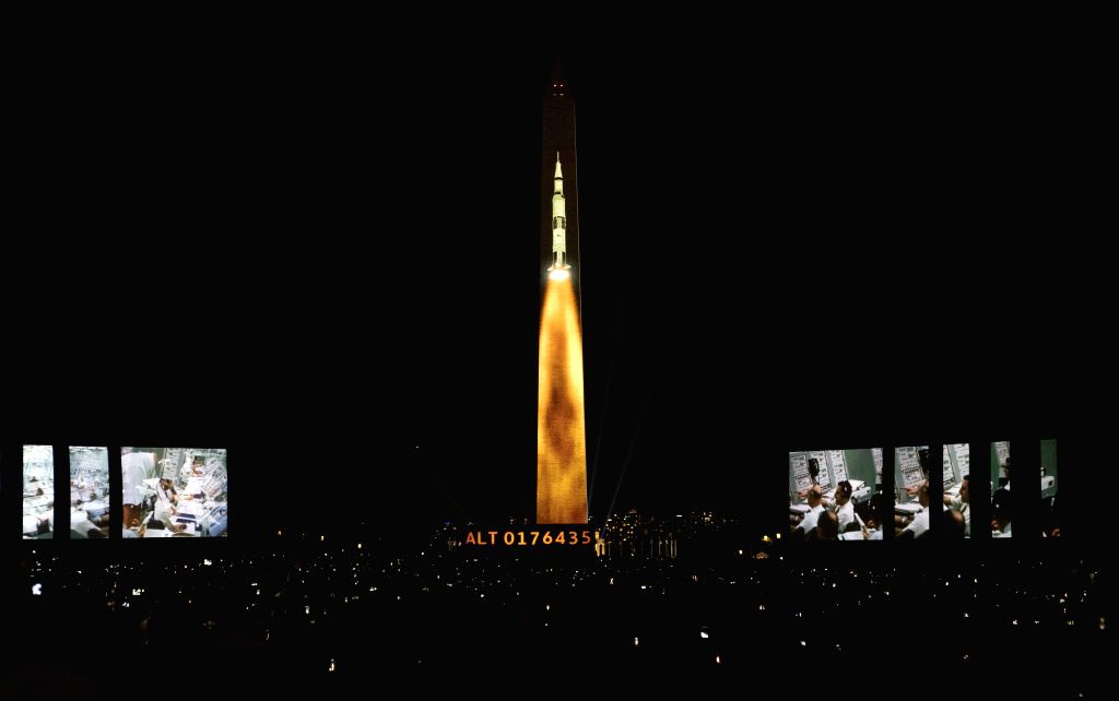 WASHINGTON, July 21, 2019 - An image of a Saturn V rocket, which was used during the Apollo 11 moon landing mission, is projected on the Washington Monument in Washington D.C., the United States, ...