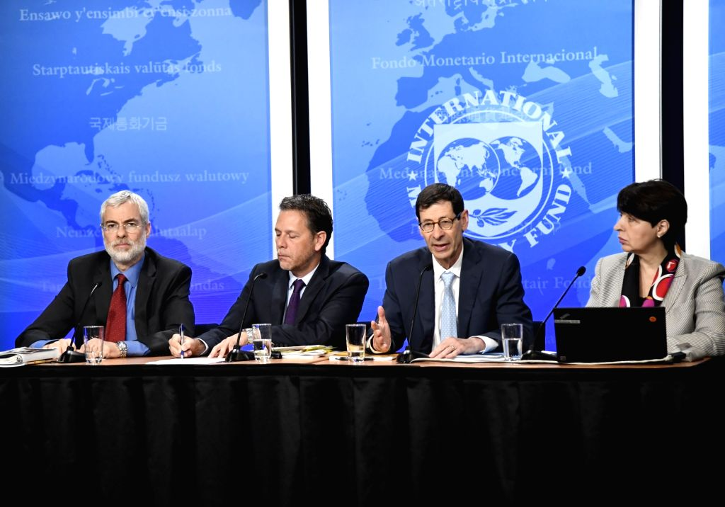 WASHINGTON, July 25, 2018 - Maurice Obstfeld (3rd L), Economic Counsellor and Director of Research at the International Monetary Fund (IMF), speaks at a press conference on the newly-released 2018 ...