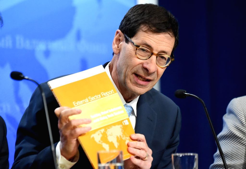 WASHINGTON, July 25, 2018 - Maurice Obstfeld, Economic Counsellor and Director of Research at the International Monetary Fund (IMF), shows the newly-released 2018 External Sector Report at a press ...