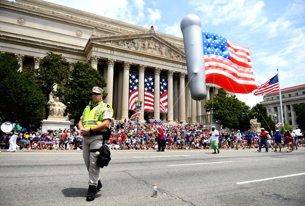 WASHINGTON, July 4, 2017 - People take part in the Independence Day parade in Washington D.C., the United States, on July 4, 2017. The United States celebrated its Independence Day on Tuesday.
