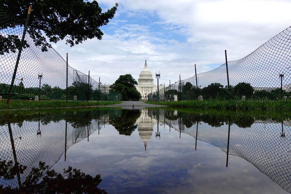 WASHINGTON, July 8, 2019 (Xinhua) -- The Capitol Hill is seen after heavy rain in Washington D.C., the United States, on July 8, 2019. Torrential rains and flash floods on Monday hammered the Washington D.C. region, stranding thousands of drivers and