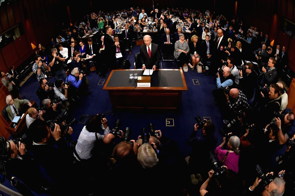 WASHINGTON, June 13, 2017 - U.S. Attorney General Jeff Sessions (C) arrives for a U.S. Senate Intelligence Committee hearing on Capitol Hill, in Washington D.C., the United States, on June 13, 2017. ...
