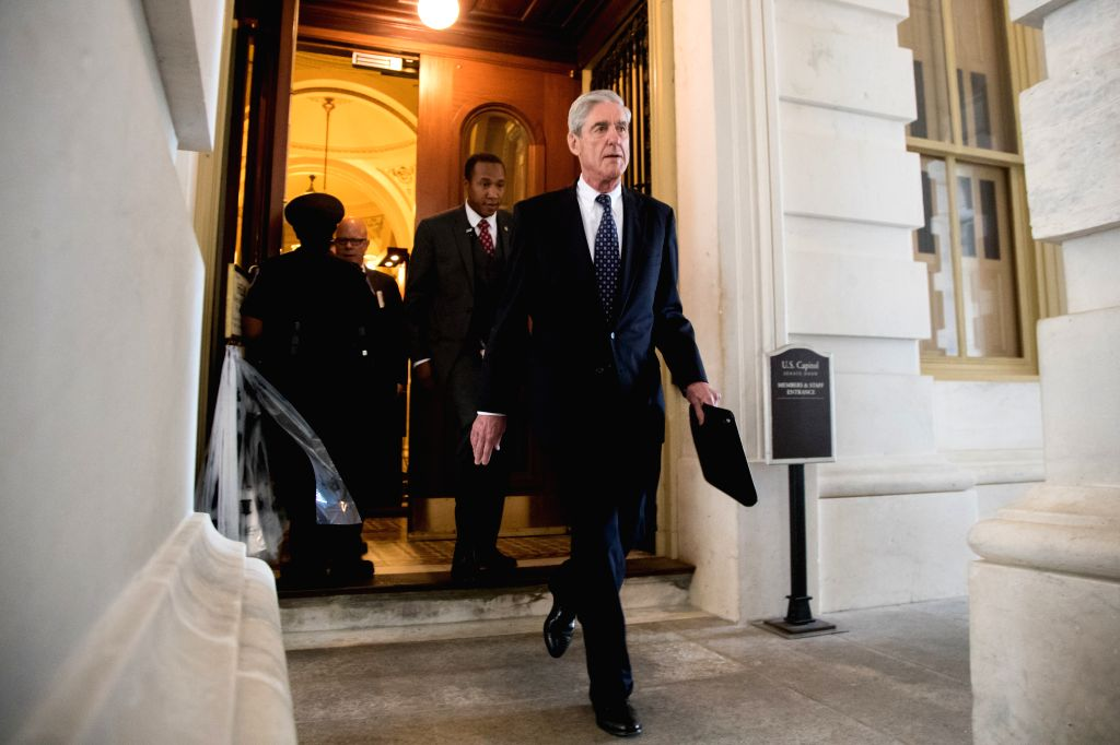 WASHINGTON, June 21, 2017 - Former FBI Director Robert Mueller (front), the special counsel probing Russian interference in the 2016 U.S. election, leaves the Capitol building after meeting with the ...