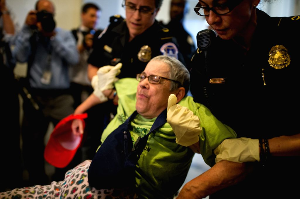 WASHINGTON, June 22, 2017 - U.S. Capitol Police remove a woman from a protest inside the Russell Senate Office Building on Capitol Hill in Washington D.C., the United States, on June 22, 2017. Senate ...