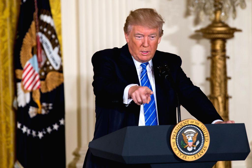 WASHINGTON, June 23, 2017 - U.S. President Donald Trump speaks before signing a new legislation at the White House in Washington D.C., the United States, on June 23, 2017. U.S. President Donald Trump ...