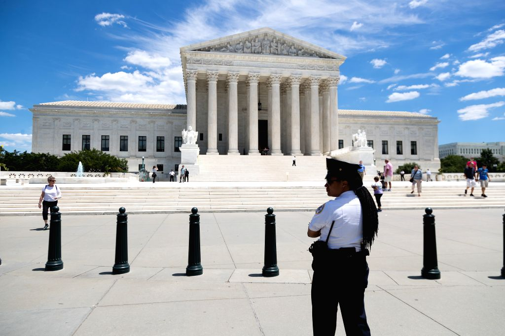 WASHINGTON, June 26, 2017 - A U.S. Supreme Court police officer stands outside the Supreme Court in Washington D.C., the United States, on June 26, 2017. The U.S. Supreme Court on Monday announced ...