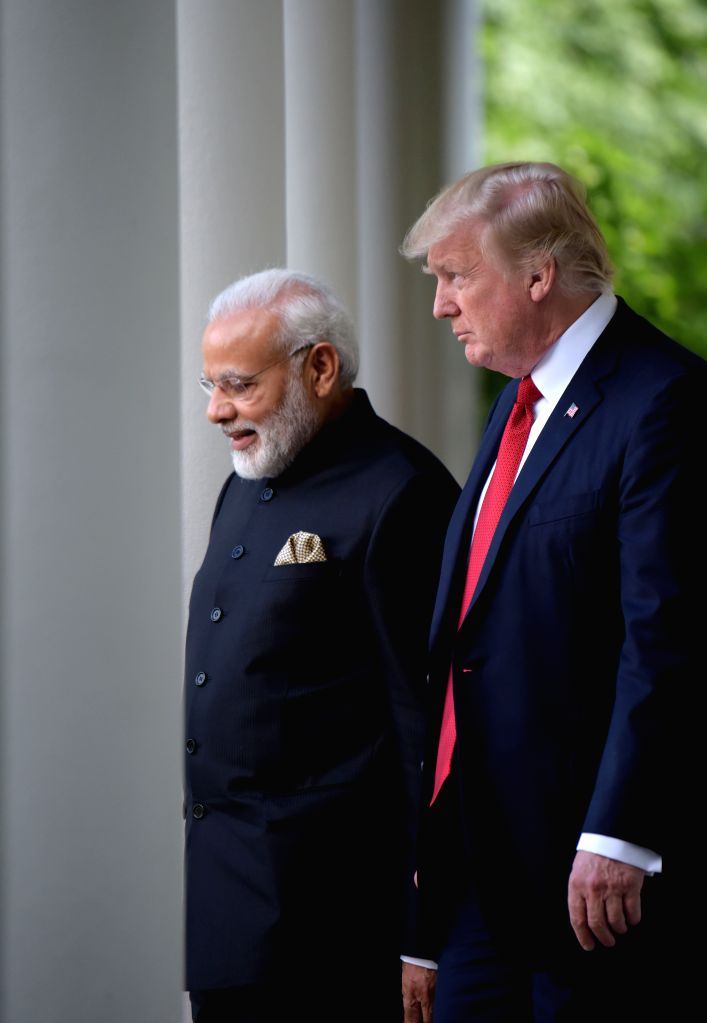 WASHINGTON, June 27, 2017 - U.S. President Donald Trump (R) and Indian Prime Minister Narendra Modi walk to Rose Garden for joint statements at the White House in Washington D.C., the United States, ... - Narendra Modi