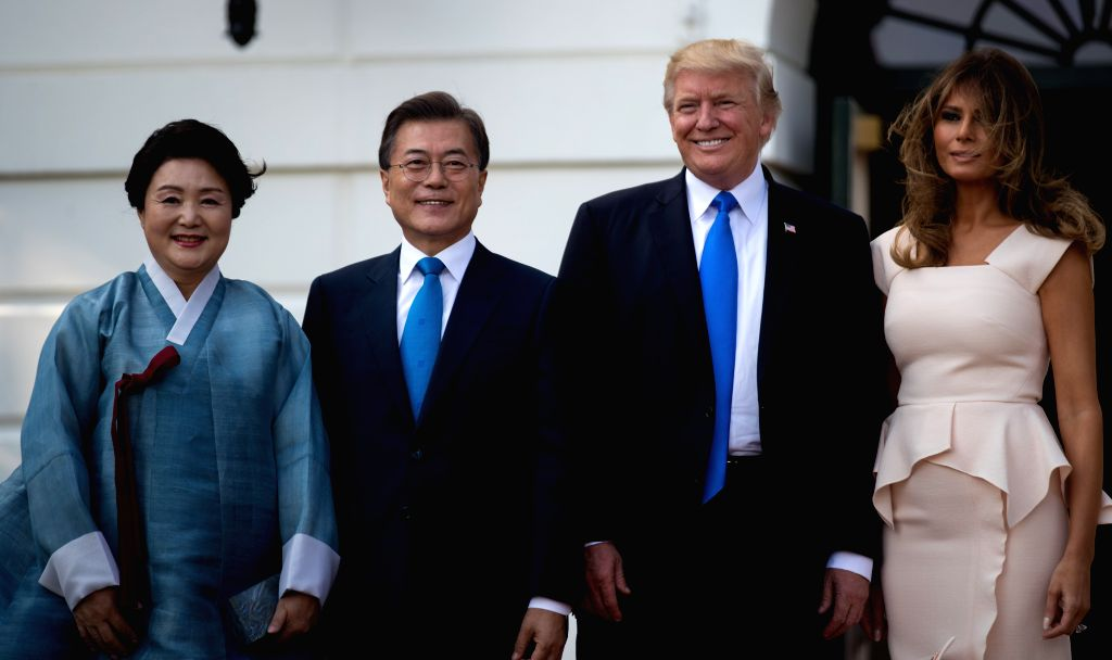 WASHINGTON, June 30, 2017 - U.S. President Donald Trump (2nd R) and First Lady Melania Trump (1st R) welcome South Korean President Moon Jae-in (2nd L) and his wife Kim Jung-sook at the South Portico ...