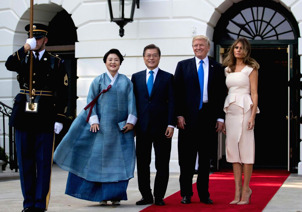 WASHINGTON, June 30, 2017 - U.S. President Donald Trump (2nd R) and First Lady Melania Trump (1st R) welcome South Korean President Moon Jae-in (3rd R) and his wife Kim Jung-sook at the South Portico ...