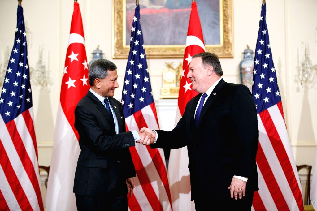 WASHINGTON, June 5, 2018 - U.S. Secretary of State Mike Pompeo (R) shakes hands with Singaporean Foreign Minister Vivian Balakrishnan during a photo opportunity at the Department of State in ... - Vivian Balakrishnan