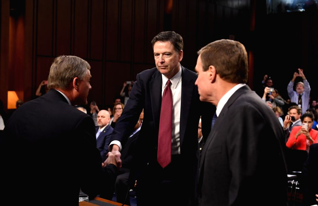 WASHINGTON, June 8, 2017 - Former Director of Federal Bureau of Investigations James Comey (C) is welcomed by Senate Intelligence Committee members before a hearing on Capitol Hill, in Washington ...