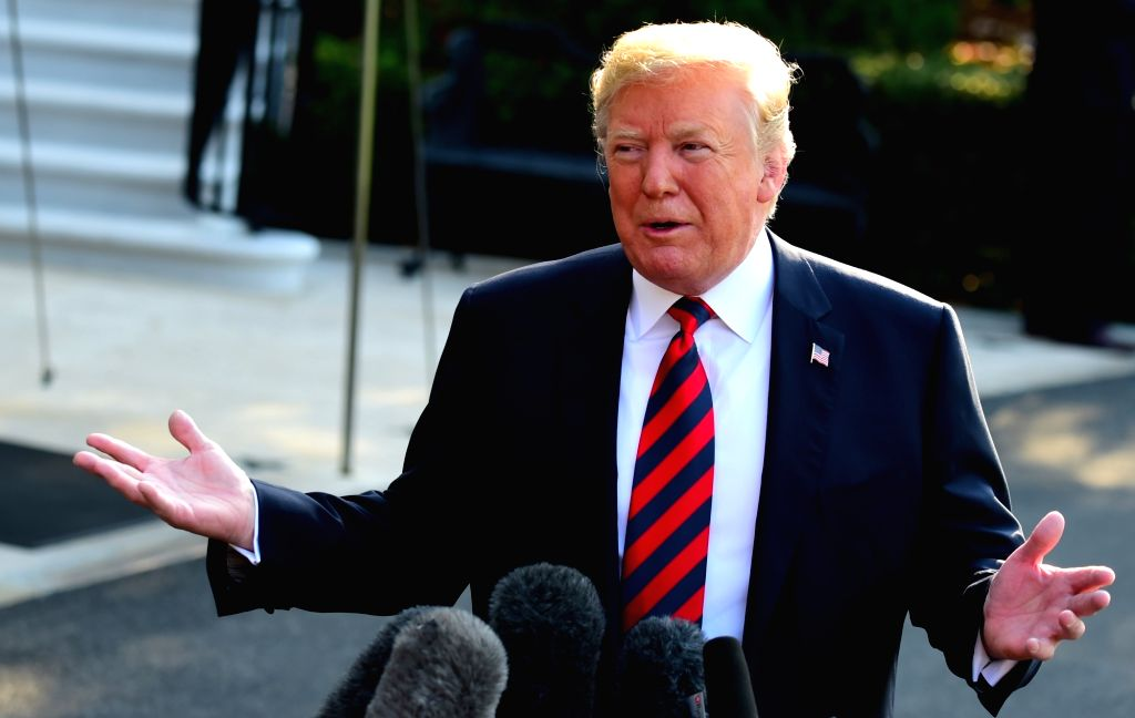 WASHINGTON, June 8, 2018 (Xinhua) -- U.S. President Donald Trump waves to the press at the White House before leaving for the G7 Summit, in Washington D.C., the United States, on June 8, 2018. U.S. President Donald Trump said here on Friday that Russ
