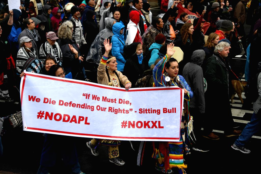 WASHINGTON, March 10, 2017 - Indigenous people from numerous tribes attend a protest in Washington D.C., the United States, on March 10, 2017. Hundreds of indigenous people from numerous tribes ...