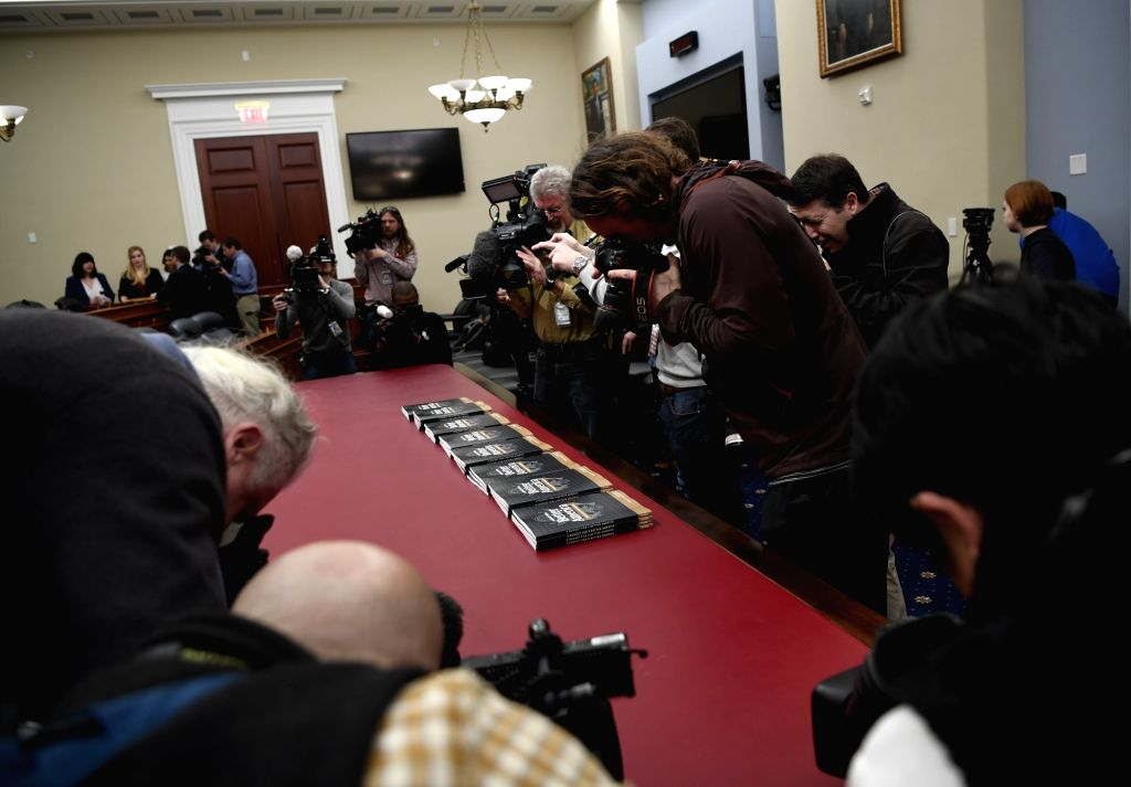 WASHINGTON, March 11, 2019 - Reporters take videos and photos of the copies of Volume 1 of U.S. President Donald Trump's budget for Fiscal Year 2020 on Capitol Hill in Washington D.C., the United ...