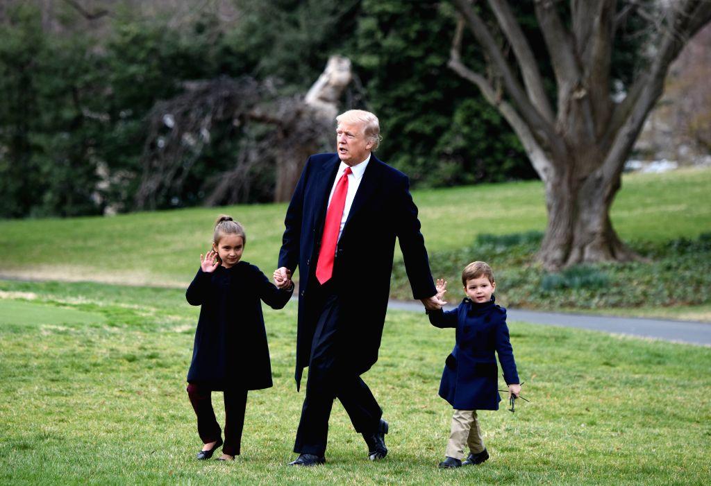 WASHINGTON, March 3, 2017 - U.S. President Donald Trump walks with his grandchildren Arabella Kushner (L) and Joseph Kushner (R) to board Marine One from the White House in Washington D.C., the ...