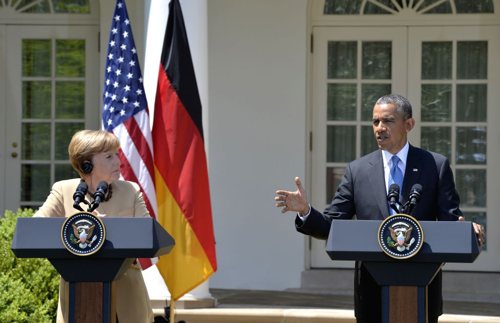 U.S. President Barack Obama (R) speaks at a joint news conference with German Chancellor Angela Merkel after their meeting at the Rose Garden of the White House in