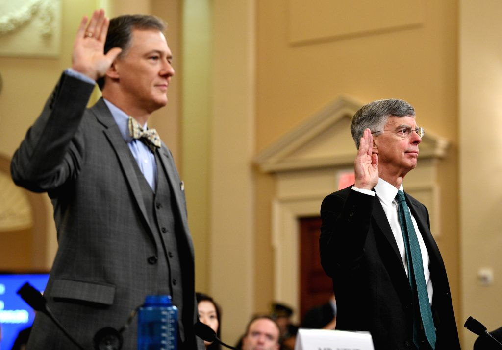 WASHINGTON, Nov. 13, 2019 (Xinhua) -- Charge d'Affairs of the U.S. Embassy in Ukraine William Taylor (R) and deputy assistant secretary of State for European and Eurasian affairs George Kent swear before the U.S. House Committee on Intelligence durin