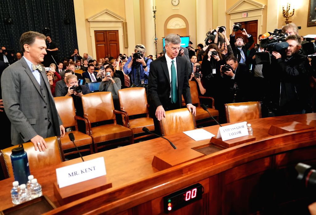 WASHINGTON, Nov. 13, 2019 (Xinhua) -- Charge d'Affairs of the U.S. Embassy in Ukraine William Taylor (R, front) and deputy assistant secretary of State for European and Eurasian affairs George Kent (L, front) wait to testify before the U.S. House Com