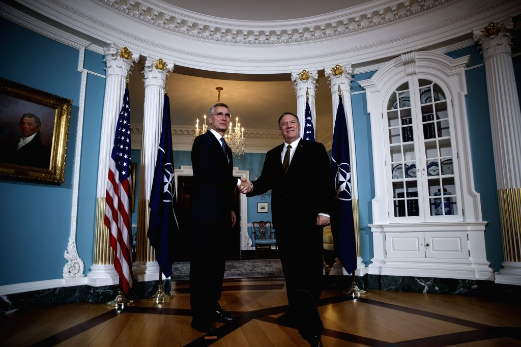 WASHINGTON, Nov. 14, 2019 - U.S. Secretary of State Mike Pompeo (R) shakes hands with NATO Secretary General Jens Stoltenberg during their meeting in Washington D.C., the United States, on Nov. 14, ...