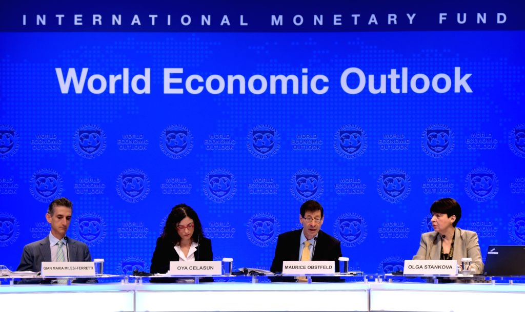 WASHINGTON, Oct. 10, 2017 - Maurice Obstfeld (2nd R), chief economist at the International Monetary Fund (IMF), attends a press briefing at the IMF headquarters in Washington D.C., the United States, ...