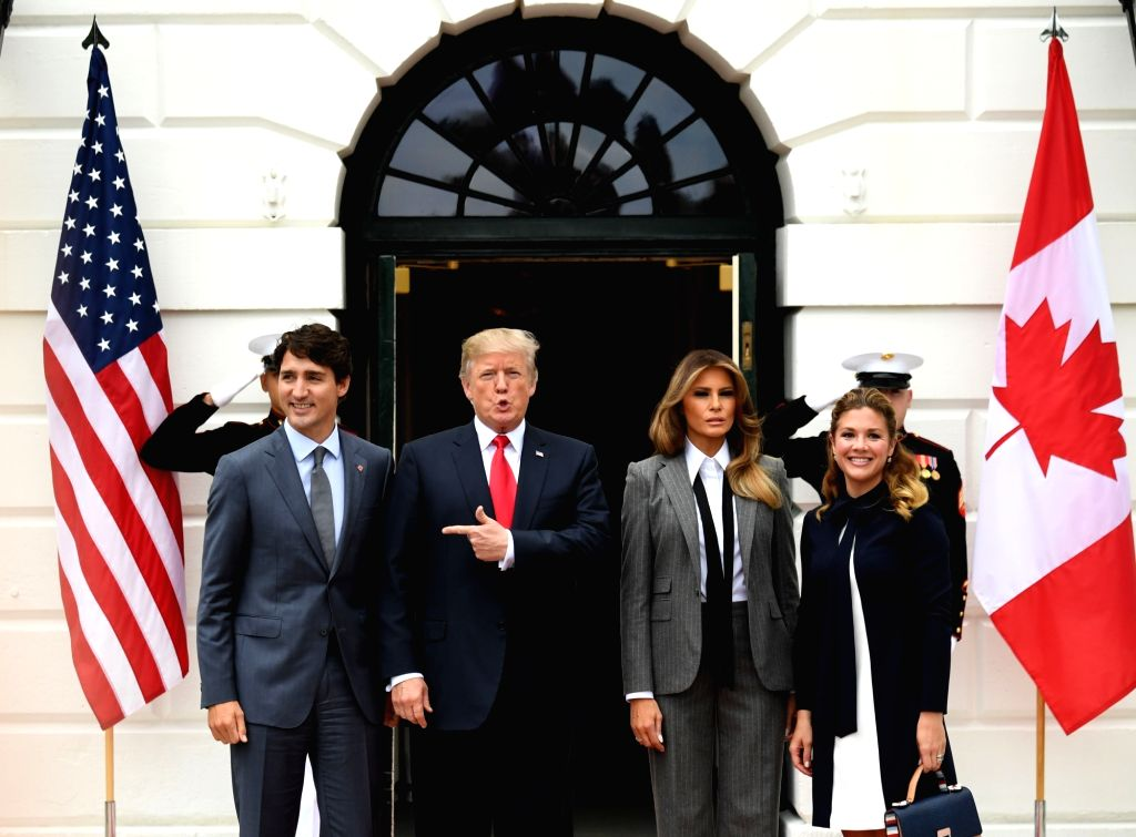 WASHINGTON, Oct. 11, 2017 - U.S. President Donald Trump (2nd L) welcomes visiting Canadian Prime Minister Justin Trudeau (1st L) at the White House in Washington D.C., the United States, on Oct. 11, ... - Justin Trudeau