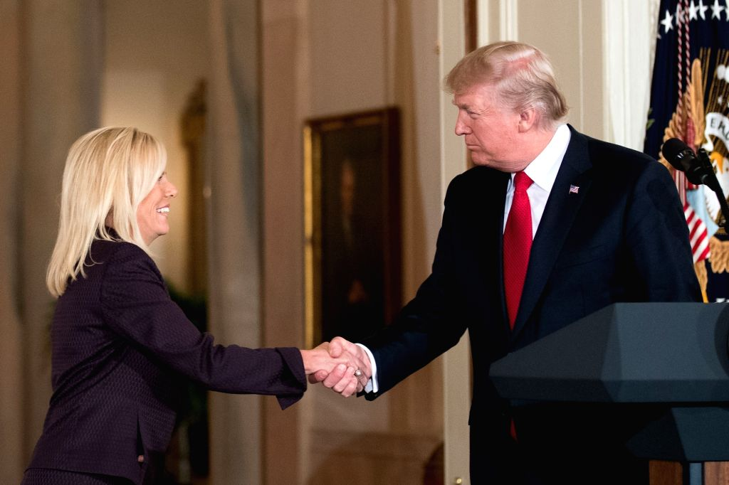 WASHINGTON, Oct. 12, 2017 - U.S. President Donald Trump (R) shakes hands with Kirstjen Nielsen during her nomination announcement at the White House in Washington D.C., the United States, on Oct. 12, ...