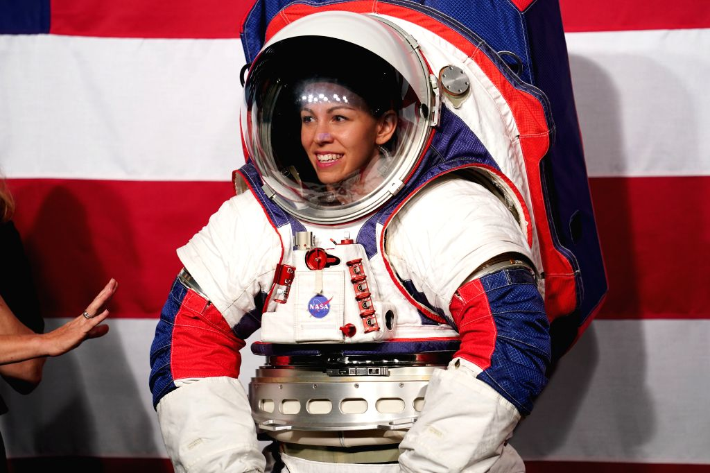 WASHINGTON, Oct. 15, 2019 - Advanced Space Suit Engineer Kristine Davis displays the Exploration Extravehicular Mobility Unit (xEMU) spacesuit at NASA headquarters in Washington D.C., the United ...