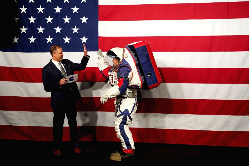 WASHINGTON, Oct. 15, 2019 - NASA Administrator Jim Bridenstine (L) welcomes Advanced Space Suit Engineer Kristine Davis, who wears the Exploration Extravehicular Mobility Unit (xEMU) spacesuit, at ...