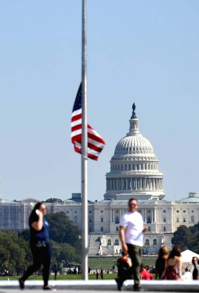 WASHINGTON, Oct. 2, 2017 - A U.S. national flag flies at half mast near the Capitol Hill to mourn the victims of a mass shooting at a concert in Las Vegas, in Washington D.C., the United States, on ...