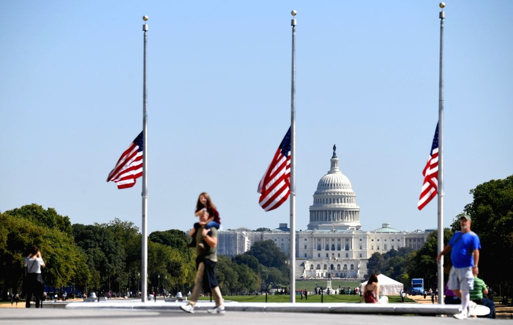 WASHINGTON, Oct. 2, 2017 - U.S. national flags fly at half mast near the Capitol Hill to mourn the victims of a mass shooting at a concert in Las Vegas, in Washington D.C., the United States, on Oct. ...