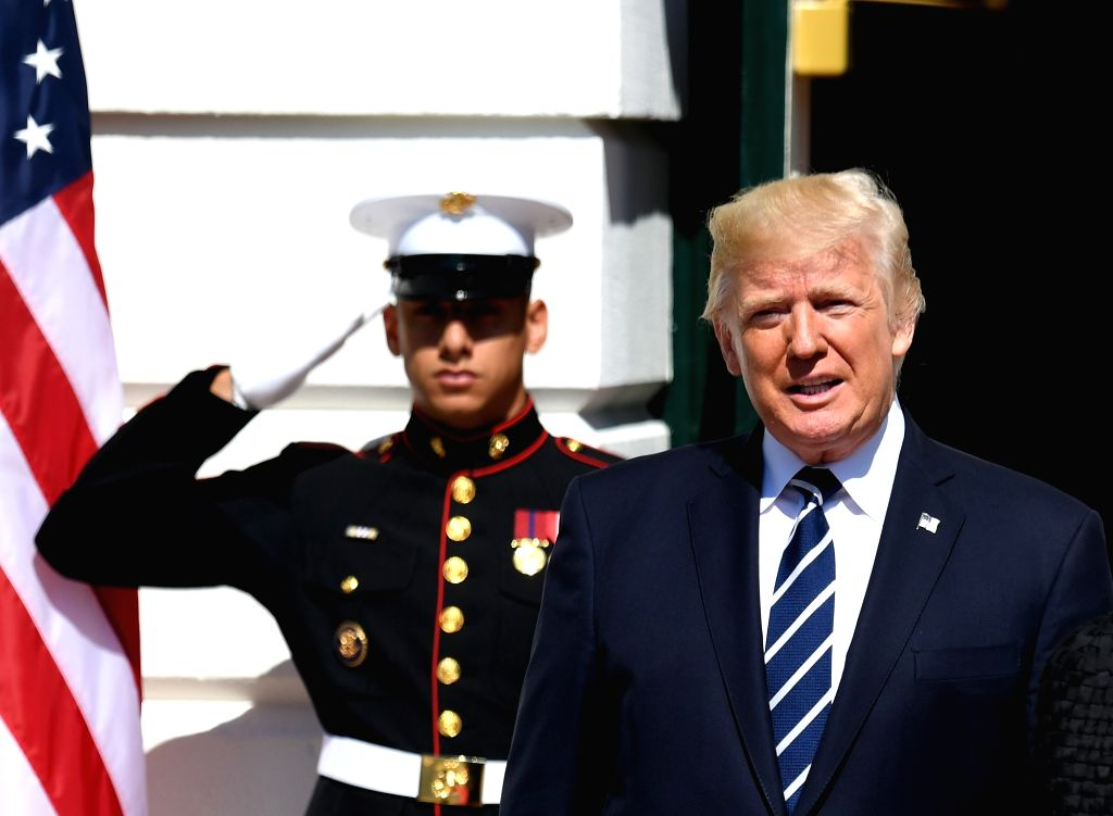 WASHINGTON, Oct. 2, 2017 - U.S. President Donald Trump (R) attends an event at the White House in Washington D.C., the United States, on Oct. 2, 2017. U.S. President Donald Trump on Monday called a ...