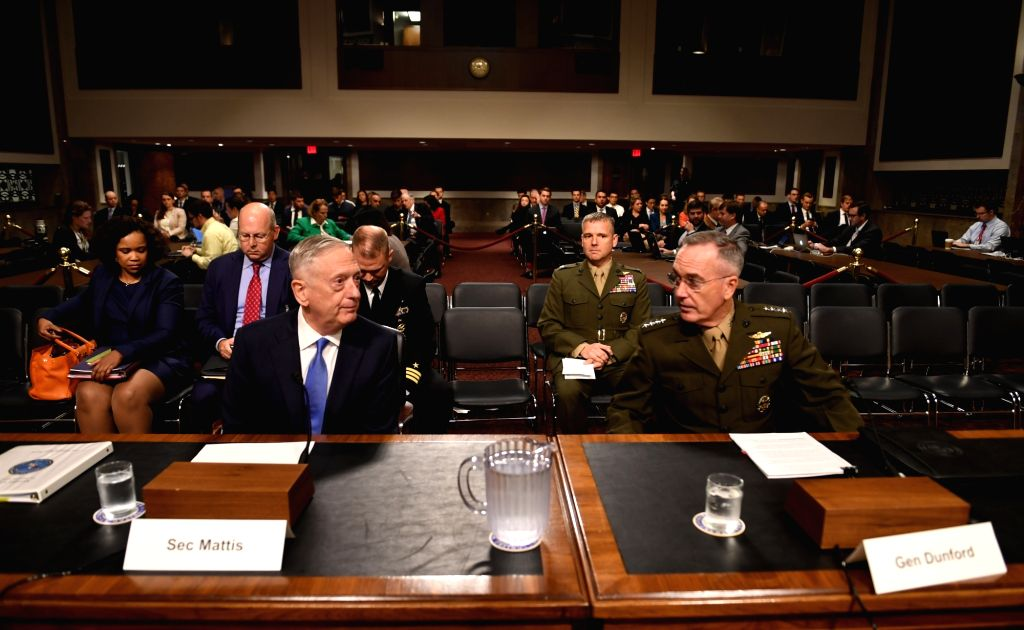 WASHINGTON, Oct. 3, 2017 - U.S. Defense Secretary Jim Mattis (L, Front) and Chairman of the Joint Chiefs of Staff Joseph Dunford (R, Front) attend a hearing before Senate Armed Services Committee on ...