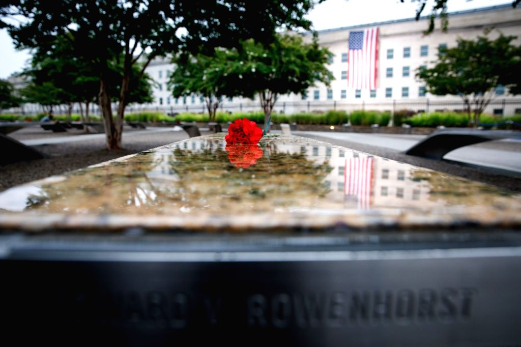 WASHINGTON, Sept. 11, 2018 - A flower is placed at the National 9/11 Pentagon Memorial during a ceremony marking the 17th anniversary of the Sept. 11 attacks in Arlington, Virginia, the United ...
