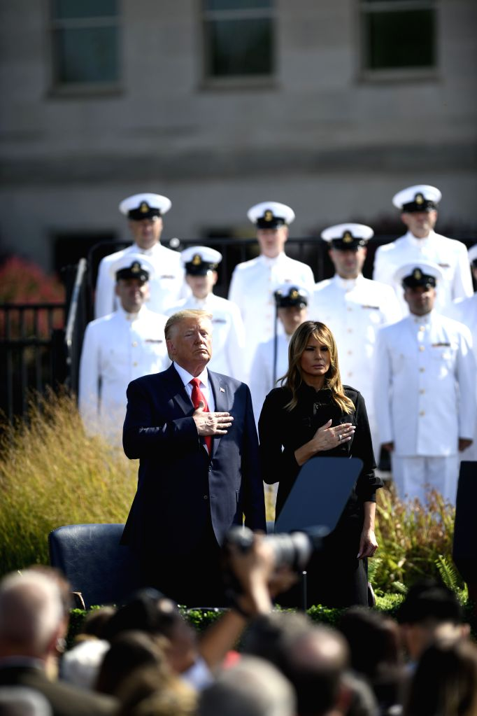 WASHINGTON, Sept. 11, 2019 - U.S. President Donald Trump (C-L) and his wife Melania Trump participate in a ceremony marking the 18th anniversary of the 9/11 attacks at the Pentagon in Arlington, ...